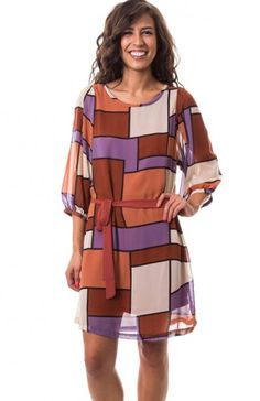 Round neck 3/4 sleeve prism loose fit dress featuring sheer sleeves, inner lining, and waist tie. Perect dress to wear on a date to a museum! $11.95