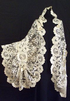 Handmade needle-run, triangular-shape silk lace shawl, c.1860, from the Vintage Textile archives.
