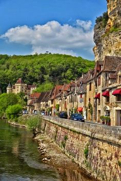 La Roque Gageac, Dordogne, France - we did actually go to a small town in this region, and it was so lovely. I very much want to go back and explore some more.