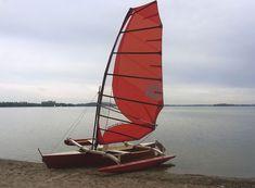 Klaus Riedl of Hamburg Germany built this Tamanu and powered it with a 10 sq meter (107 sq ft) windsurf sail. Windsurf technology...