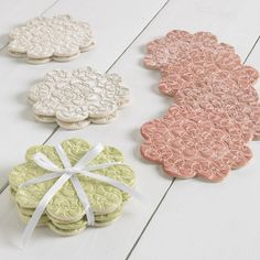 Tatted Flower Coasters (set of 4)  $30.00 Made from pressing vintage crocheted or tatted doilies into clay, molded into plates, wall hangings, serving platters and fired.