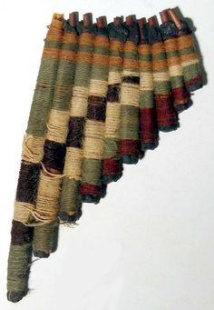 "Nazca from Peru, 400-700 AD. An extremely rare antara (pan flute). The instrument is 6"" long and is made from reed tubes wrapped with colored yarn."