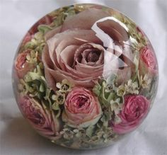 Preserved Bridal flowers in a paperweight by The Flower Preservation Workshop