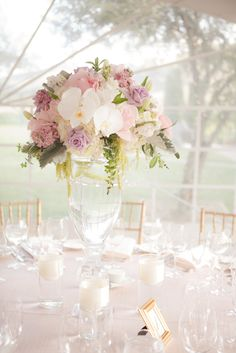 Hydrangea, pink stock, lavender roses, orchids, lisianthus