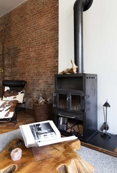 that wood stump table! Maybe get one by Wake the Tree? // vtwonen home tour with black fireplace and exposed brick wall / sfgirlbybay Rotterdam, Wood Stumps, Stump Table, Concrete Interiors, Interior Styling, Interior Design, Gravity Home, Black Fireplace, Vintage Room