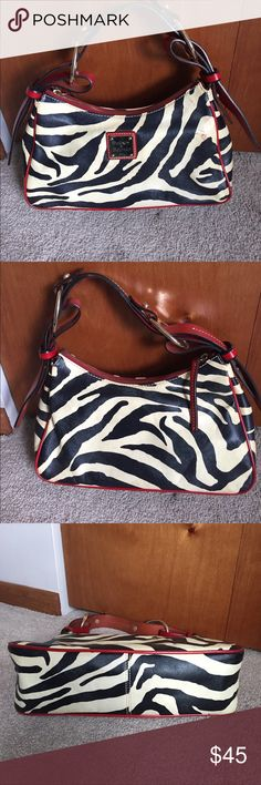 Dooney and Bouke medium hobo bag Zebra print black and cream with red detail and straps. Good condition. Mark on the front. See picture. Some normal staining inside but in good shape. The dust bag was lost in a move I believe. Dooney & Bourke Bags Hobos