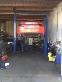This is a great picture of what it looks like to get your car fixed. I really like to stay and watch to see how they fix my car. My dad used to be a car mechanic, so that may be where I get my curiosity. I have to take my car in soon to get it repaired but I might just ask my dad to take a look at it.