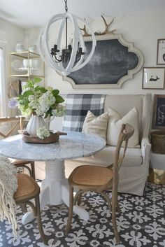 Love the graphic tile floor in this cozy kitchen eclecticallyvintage.com
