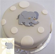 The cake was made to match the invitation. Elephant Baby Shower.