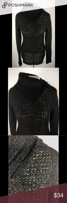 """NEW Free people Black Loose Knit Tunic Sweater M Beautiful and soft sweater from Free People. Tunic length with a faux cowl neck. Gorgeous loose knit as you can see in the photos.  Perfect for Fall and Winter skinny jeans and boots! You'll love it - grab it! 49% Wool, 18% Acrylic, 33% Polyester Chest measured flat across - 18"""" Sleeve 21"""" Overall length 26"""" There is some stretch for accommodation Free People Sweaters Cowl & Turtlenecks"""