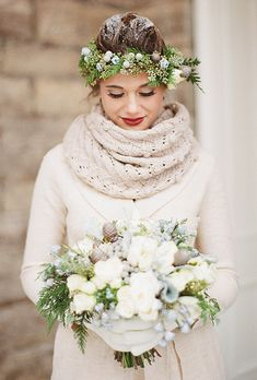 A wedding hairstyle with evergreen with frosted winter berries and pine cones for a winter wedding | Brides.com