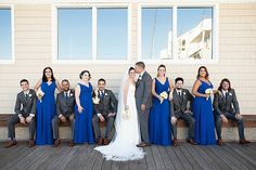 A royal blue and blush travel themed DIY wedding at The Water Table in Virginia Beach photographed by Maria Grace Photography.