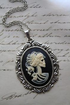 creepy but i like it for some reason...Cadaver animatum necklace - gothic skeleton cameo lady lolita