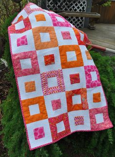 Brightly coloured baby quilt