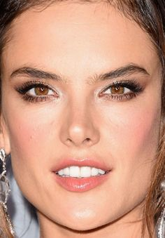 These peachy-pink gloss and blush tones always look fab on her, and I love how she does her brown smoky eyes.