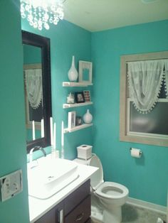 Very nice color scheme. With this paint color, the accessories must not conflict, and they don't! But before you make up your mind about your bathroom decor, take a good look at http://www.bathroom-paint.net/bathroom-paint-color.php
