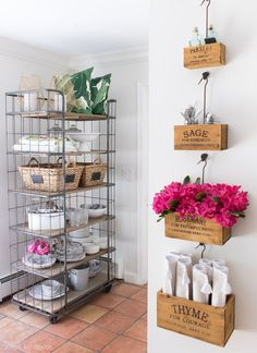 A baker's rack adds extra storage space in the kitchen and wall-mounted crates keep tabletop necessities close at hand - Interior Design Fans Spring Home, Autumn Home, Spring Style, Kitchen Decor, Kitchen Design, Kitchen Storage, Patio Storage, Storage Cart, Storage Room