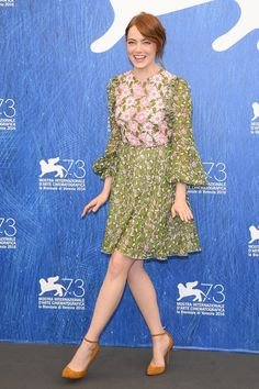 Emma Stone brightens up the Venice Film Festival in a floral dress complete with embroidery and ruffles by Giambattista Valli.