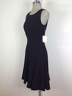 42c4ae1a1f2 Calvin Klein NEW Black dress flare bottom sexy elegant dress NWT
