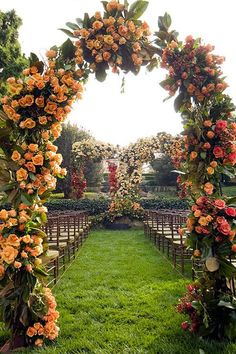 pink and orange roses wedding arch