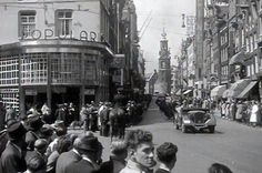May 1940. A convoy of vehicles of the German Wehrmacht occupation at the Reguliersbreestraat and Rembrandtplein in Amsterdam. In the background the Munttoren and on the left cafeteria Heck's Popularis. After the capitulation of the Dutch armed forces on May 15, 1940, German troops occupied The Netherlands and Amsterdam. #amsterdam #worldwar2 #Reguliersbreestraat #Rembrandplein