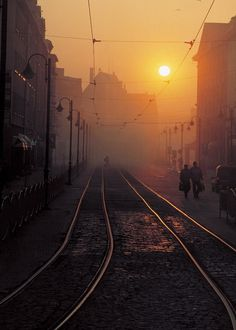In the photograph is Elblag (Poland) as well as at sunrise and the mist from the Slavic Square. Photo taken with Canon EOS 300 on the negative sunrise Sunrise Photography, Street Photography, Beautiful Sunrise, Urban Life, Sunset Photos, Nature Photos, Train Tracks, Beautiful World, Beautiful Places