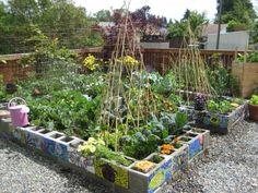 Cinder Block Raised Beds. Add mosaics to sides of cinderblocks for some garden art.
