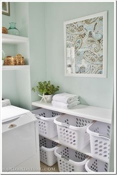 Laundry Room Sorting Station......wow! Does anyone's laundry room really look like this???