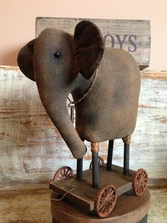 Primitive Elephant Pull Toy via Etsy