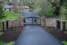gated driveway entrance ideas | Stone & Iron Gate Driveway Entry