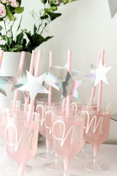 Love the personalized glasses! Beautiful Bridal Shower Decorations for the Modern Bride! Decorate with the Iridescent Martha Stewart Celebration Line, and personalize your party with the Cricut Explore 2! You're bride will be thrilled with the subtle glitter and glam in these pink and silver decorations! #cricutexplore #bridalshower #modernbride #woodaccents
