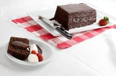 """Dressy Chocolate Loaf Cake: Please don't tell my """"gym-rat"""" friends, this chocolate cake is totally worth the calories, meaning I am willing to work out a little extra just to eat this. Yummy Treats, Sweet Treats, Chocolate Loaf Cake, Cake Recipes, Vegan Recipes, Gym Rat, Vegan Food, Sour Cream, Frozen"""