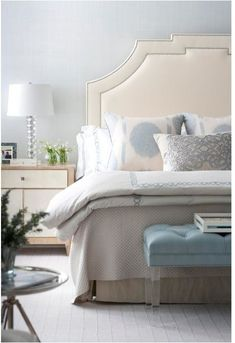 With this bedroom, the wall color choices are blue to pick up on the blue accents, or a pale ivory shade to relate to the headboard. There appears to be a green-grey or taupe coverlet and bedskirt here but they are not as visual as the cream and blue making the blue-grey an obvious wall color choice.