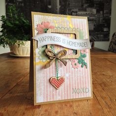 "Happiness Is Homemade Card; DP: Studiolight; wood veneers: Crate Paper (""Little Boy Blue""); ink: Delicata, SU; embroidery wood shape: Rico Design; flowers: Maggie Holmes (""Open Book"")."
