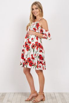 Cold shoulders are all the rage this season. We love the chic floral print and pretty layered design on the front. Style this maternity dress with strappy sandals and a sun hat for a perfect summertime look.