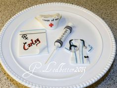 Items similar to Set of 4 Edible Cake Toppers Nurse Scrub and Hat / Syringe / RX pad / on Etsy Fondant Cake Toppers, Nursing Graduation, Nurse Gifts, Unique Jewelry, Handmade Gifts, Hat, Etsy, Degree In Nursing, Kid Craft Gifts