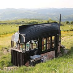 Alex Holland's Boat Roofed Shed is perched in the Cambrian Mountains and features a fridge, gas cooker, sink and a sound system for 'shed' parties