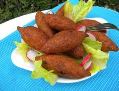 Fried Potato Kibbeh Balls...The outer shell is made with mashed potatoes and kneaded with fine bulgur. The dough is stuffed with a filling of minced beef or lamb and walnuts, seasoned with sumac, allspice, cinnamon powder and chili flakes image 1