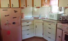 vintage-pink-trailer-kitchen from a restored 1958 Universal Terra-Cruiser trailer in Arizona via Retro Renovation