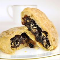 Eccles Cake Recipe   Eccles cakes aren't cakes, but small flat pastry filled with dried fruits and spices from Eccles in North West England and were first made in Eccles in 1793.