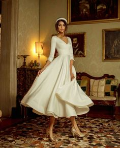 Satin midi wedding dress Kriss with sleeves and V-neckline.♥ Recommended sizes are 34 euro - 42 euro. It is also possible to make your dress by measurements.We believe in your uniqueness and create only for you! Civil Wedding Dresses, Dream Wedding Dresses, Bridal Dresses, Bridesmaid Gowns, Vintage Wedding Gowns, Tea Length Wedding Dress, Tea Length Dresses, Wedding Dress Midi, Gown Wedding