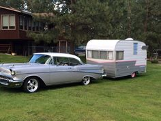 Old chevy car and shasta camper matching set