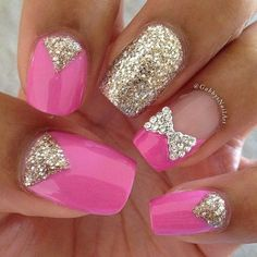 Carnation pink polish with silver glitters on top forming v-shapes.