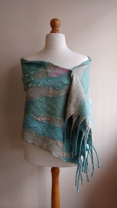 Check out this item in my Etsy shop https://www.etsy.com/uk/listing/481372511/felted-wool-chunky-scarf-women-nuno-wrap