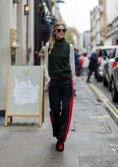 So hat man das It-Girl und Model noch nie gesehen. Statt feinem Kostüm oder hautenger Jeans zeigt sich Olivia Palermo nach dem Fashion-Show-Marathon in einer weißen Bluse mit einem grünen Pullunder. Untenrum das totale Novum: eine schlabbrige Trainingshose in Schwarz-Rot von Designerin Mary Katrantzou. Darunter blitzen schwarze, spitze Pumps.