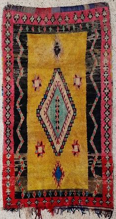 Modern Berber Rag woven pile rug. The traditional Boucherouite, which means torn and re-used clothing, nowadays includes cotton, wool and nylon.