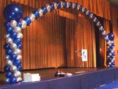 Balloon Pillars  Arch. I want to crisscross the arches. may even do 6 pillars.    Gold, Green and Purple twists.