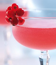 GREY GOOSE® Cherry Rose | Irresistible cherry with dry vermouth and red currants makes for a deliciously refreshing summer cocktail.| GREY GOOSE® Cherry Noir 1 ½ Parts NOILLY PRAT® Original French Dry Vermouth 1 Part Sugar Syrup ½ Part Sprig of Fresh Red Currant