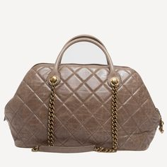 Chanel Castle Rock Bowler Quilted Leather   From a collection of rare vintage handbags and purses at https://www.1stdibs.com/fashion/accessories/handbags-purses/