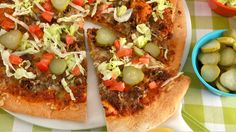 Cheeseburger Pizza - Recipes - Best Recipes Ever - Racing against the clock? This pizza will come out of the oven in no time flat. Then just add some cheeseburger-inspired toppings, such as pickled hot peppers, diced tomatoes and shredded lettuce. For a healthy, easy Pizza Crust option, try...